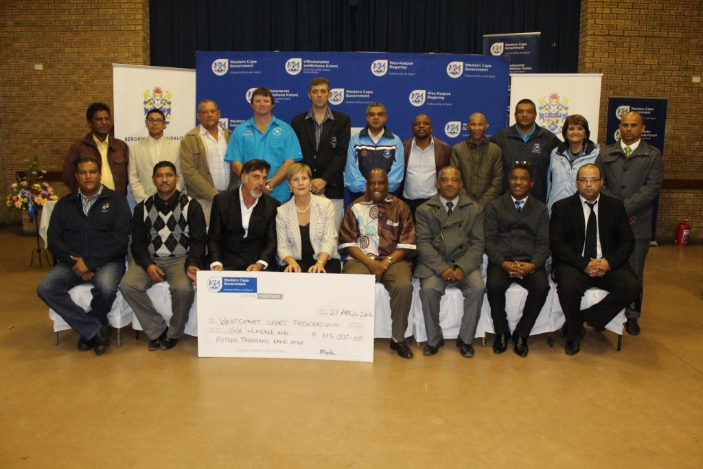 Minister Marais with other DCAS officials and the recipients of the cheque of R615 000