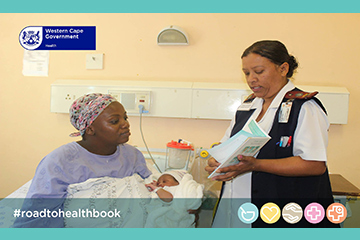Nurse showing mom the new Road to Health booklet.