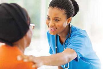 Nurse talking to patient.
