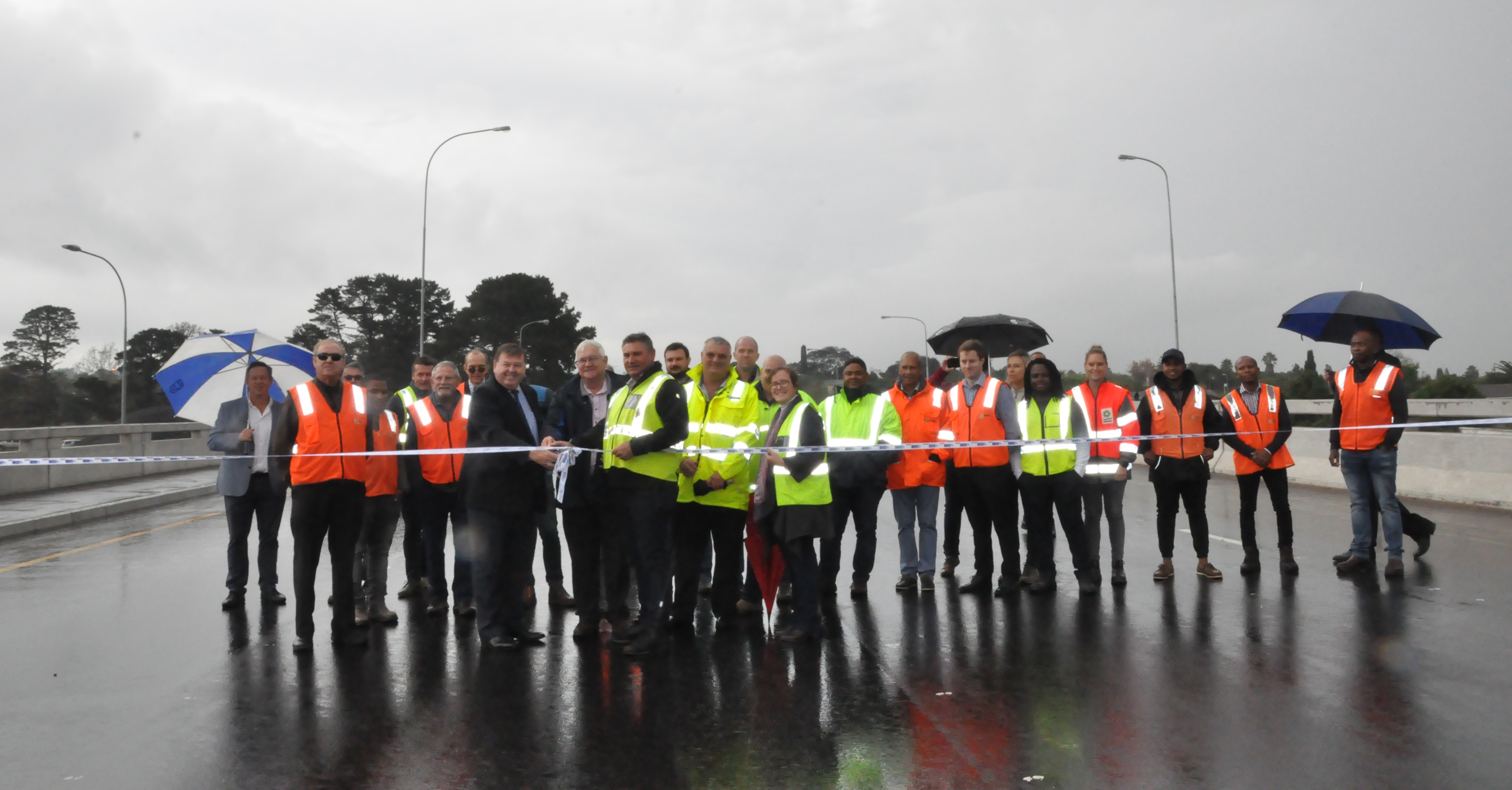 Minister Grant and officials of the department as well as members of the project team, at the official ribbon-cutting ceremony on the new Old Oak Bridge.