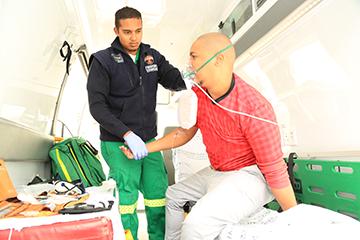 paramedics assisting patient