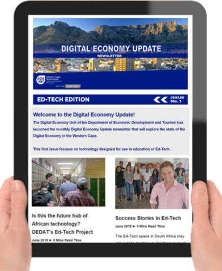 Picture of person holding table with the Digital Economy Update newsletter on the screen
