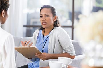 psychologist talking to female patient.