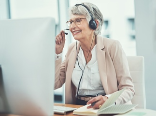 Senior woman working at a call centre