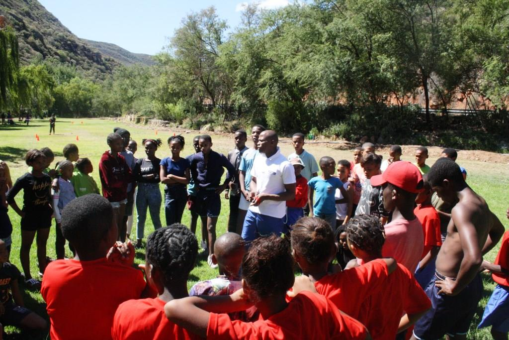 Sicelo Ngxanga (centre) explaining the rules of the various indigenous games