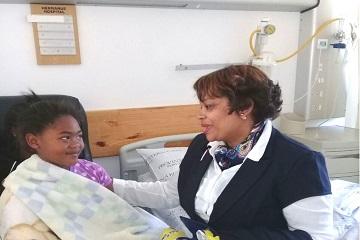 Nurse checking on child patient.
