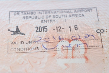 South Africa entry stamp in traveler's passport in OR Tambo international Airport closeup photo