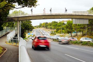 Car speeding in rush hour traffic