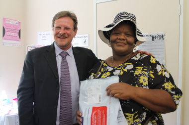 Nomonde Patience Nongogo (50) received the 5th million chronic medication parcel from the Western Cape Minister of Health, Mr Theuns Botha at the Gugulethu Community Health Centre.