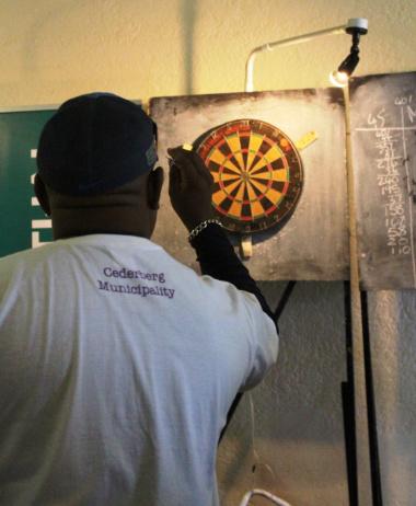 A Cederberg Municipality staff member participating in a game of darts