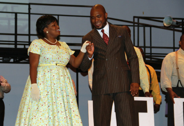 A charismatic Nelson Mandela played by Aubrey Poo and Winnie Mandela played by Siphamandla Yakupa.