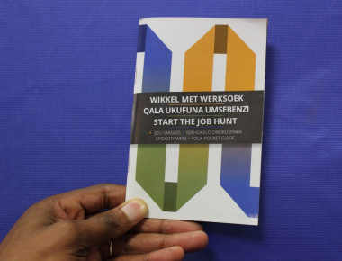 "A copy of the multilingual ""Start the Job Hunt"" booklet."