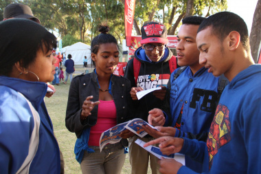 A group of learners interact with Tracey-Lee Thomas of the DCAS MOD programme.