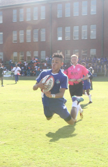 A learner from the Western Cape Sport School scores a try