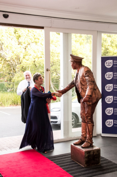 A mime welcomes Minister Anroux Marais to the 2016/17 Cultural Affairs Awards at the Lord Charles Hotel