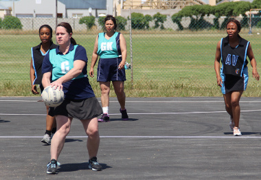 A netball player prepares to make a pass during one of the matches