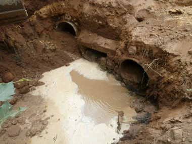 A pipe culvert being repaired.