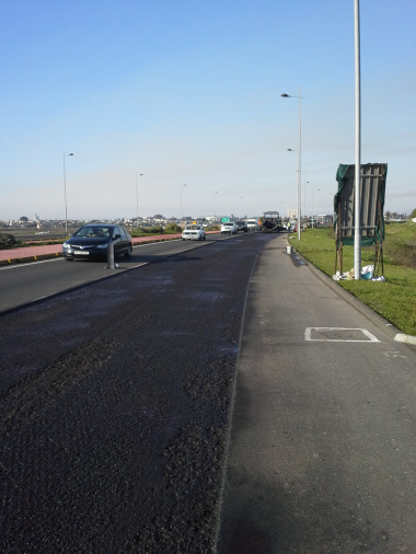 A section along the northbound carriageway of the R27 where the existing road surface has been milled out.