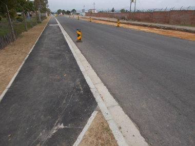 A side walk  provides pedestrians with a safe area to walk between the communities of Bloekombos and Denovo.