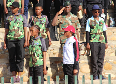 A soldier from the SA Army Infantry School salutes during the singing of the national anthem.