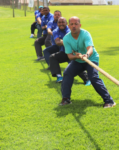 A team from the Department of Health holds on during a match of tug-of-war.