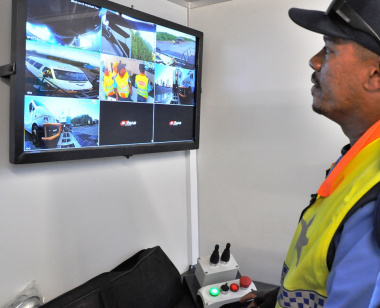 A traffic officer inspects the results of the mobile weighbridge operation.
