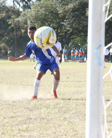 A young boy from the Western Cape showing his soccer skills