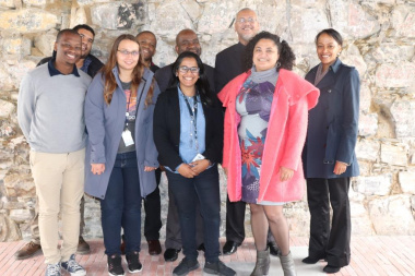 Acting DCAS HOD Dr Bouah with Dr Dlamuka and the Heritage Team at one of the restored walls inside the Old Granary Complex