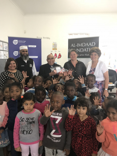 From left to right, Judy Philand (Principal), Yusuf Rajah (Al-Imdaad), MEC Fritz, Odette Tesner (ECD Teacher), and Rev. Cathleen Smith (ECD Chairperson)