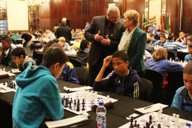 Adv. Lyndon Boauh of DCAS and Minister Marais observing young players at the SA Chess Open