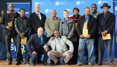 Adv. Lyndon Bouah, Wato Kobese and Anroux Marais with the representatives of the schools.
