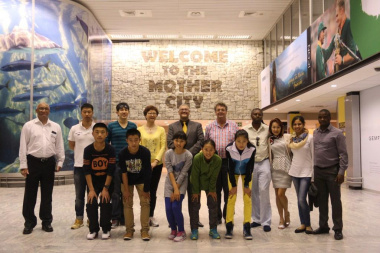 Adv Lyndon Bouah, with the youth delegation from the Qingdao Water Sports Administration Centre in Shandong, China and DCAS staff members at Cape Town International Airport