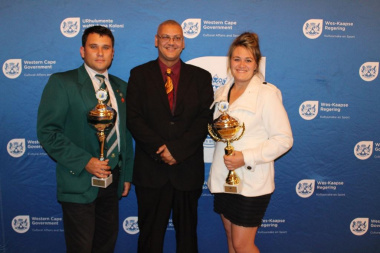 Advocate Lyndon Bouah, Chief Director of Sport at DCAS with the Sportsman and Sportswoman of the Year 2015, Ruehan van Romburgh and Annelie Stevens
