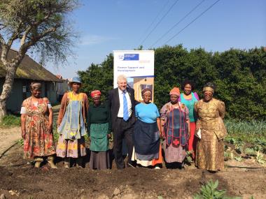 Minister Alan Winde with members of the Siyazama food garden.