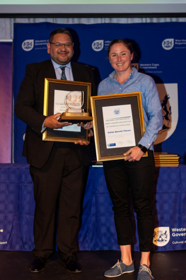 Aimee Barrett-Theron accepts her award from DCAS HOD Brent Walters
