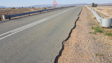 An example of where the road pavement structure has failed.