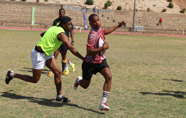 An SA Infantry School player cuts through a gap during a touch rugby game.
