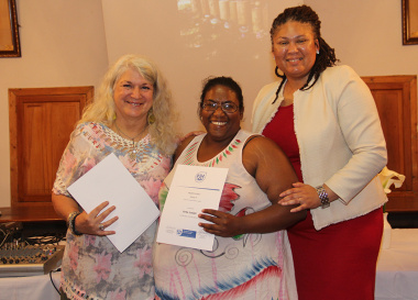 Anita Joseph (centre) receives her certificate of participation from DCAS assistant director, Liezl Jansen (right), in Genadendal on Thursday