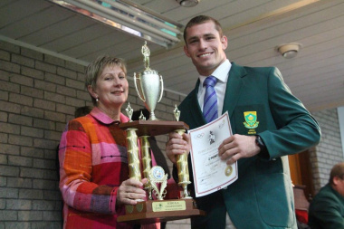 Anroux Marias hands over the Best Senior Male Judoka award to Zack Piontek