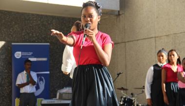 Aqeela Solomons of Cedar High School performs a song.