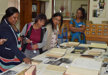 Archivist, Amanda Mdawe (left) assisting Public Administration learners from the Cape Peninsula University of Technology at the Education Exhibition in the Archives Library.