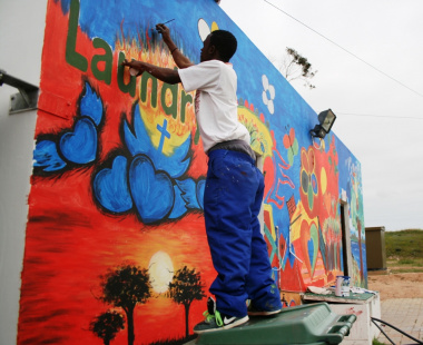 Artist pays attention to detail on the mural painting.