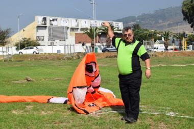 Ashley prepares the lifter kite to aid the flight of their handmade Nemo kite.