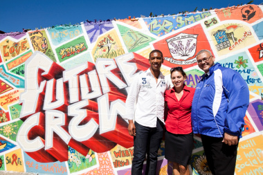Ashwin Willemse, Theresa Kearly (Virgin Active) and Adv Lyndon Bouah (Department of Cultural Affairs and Sport) in front of the FUTURE CREW mural, which was unveiled at the school.