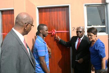 Beneficiary, Darius Mdoda receiving his new home.