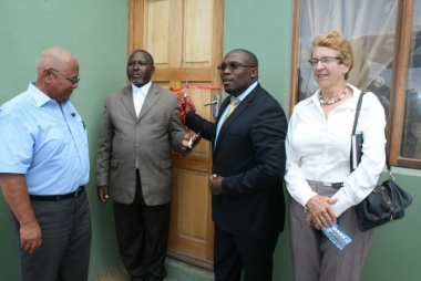 Human Settlements MEC Bonginkosi Madikizela handing over keys to beneficiary Gadilanga Alson Bonisile