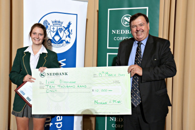 Minister of education Donald Grant and the winner of Nedbank busary competition Miss Lené Dippenaar from Tygerberg High School