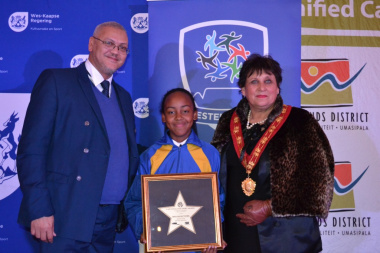 Athlete Sha-Lian Matthews received a recognition award for her excellent achievements