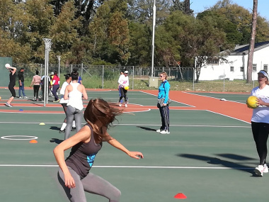 Athletes take part in the ball skills drill at the high-performance training camp