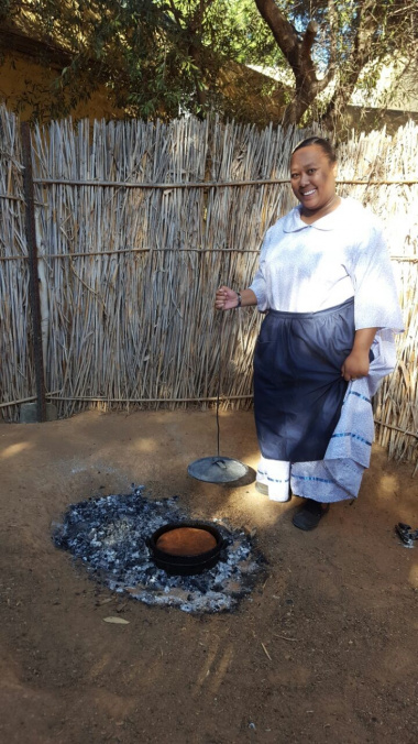 Audelia Chales demonstrating how pot bread is prepared